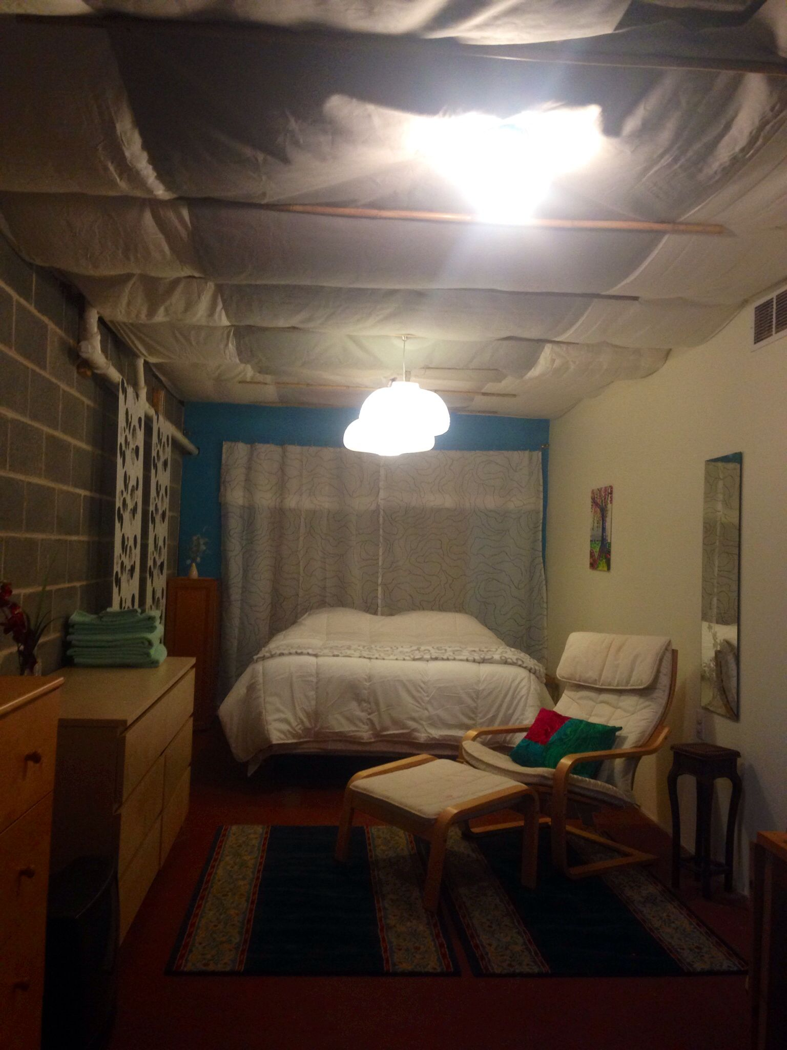 Diy Basement Ceiling Cover With Sheets And Staple To Every Other Floor Board I Covered Staples With Small Basement Bedroom Diy Basement Basement Guest Rooms