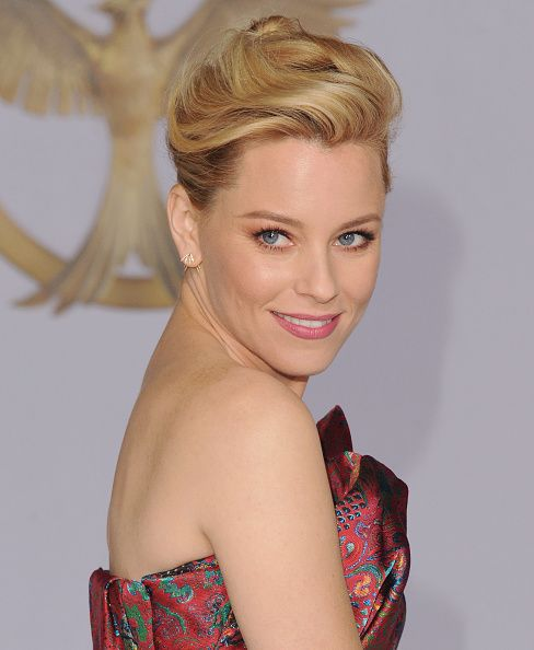"""Elizabeth Banks at """"The Hunger Games Mockingjay Part 1"""" Los Angeles Premiere. Makeup by Fiona Stiles for Estee Lauder. Styled by Wendi & Nicole."""