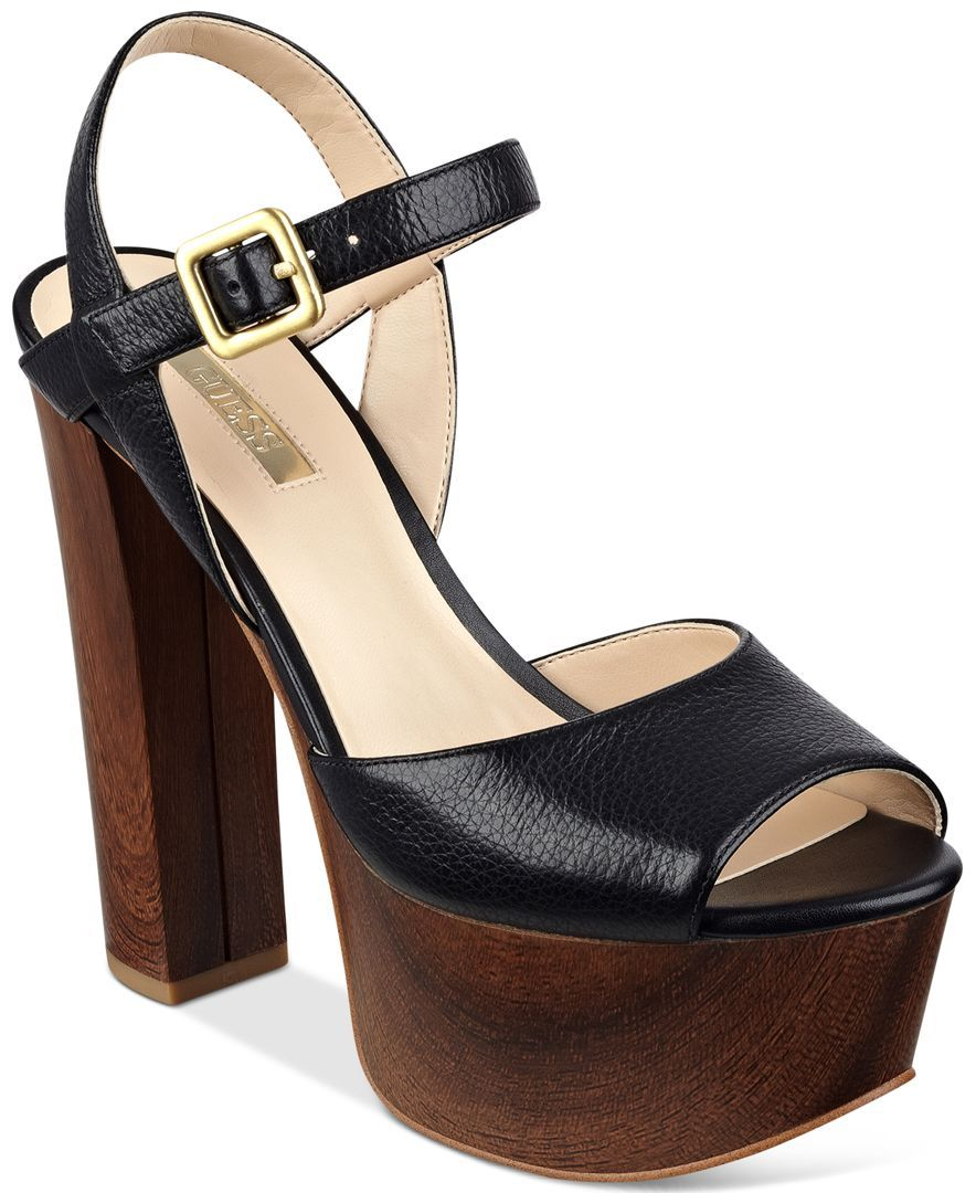 0b66255d83 Guess' retro Den sandals have a wood-look platform with enough height and  chunky style to be right at home in the 70s. | Imported | Leather upper |  Round ...
