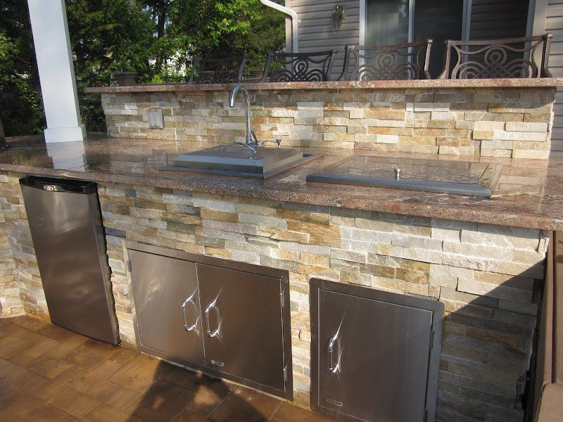 Outdoor kitchen with dual bar top featuring outdoor fridge for 3 4 inch granite countertops