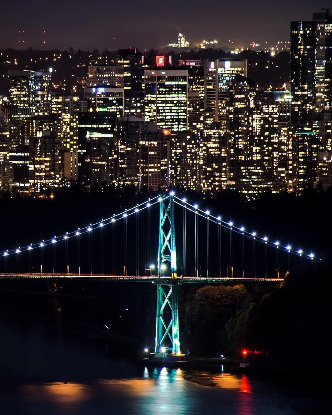 Big City Lights The Lions Gate Bridge Crosses The Burrard