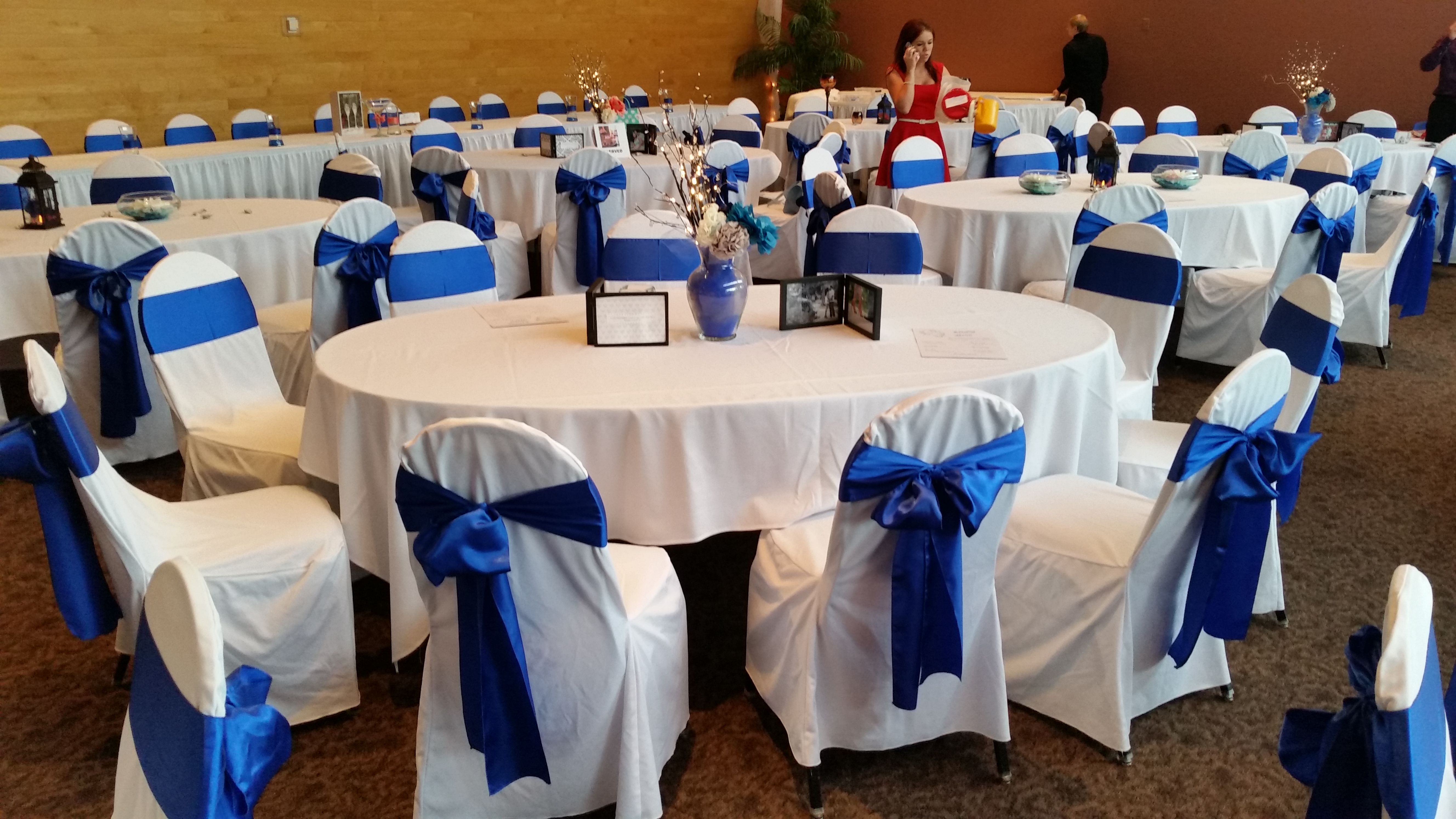 White Chair Covers with Royal Blue Satin Sashes traditional bow