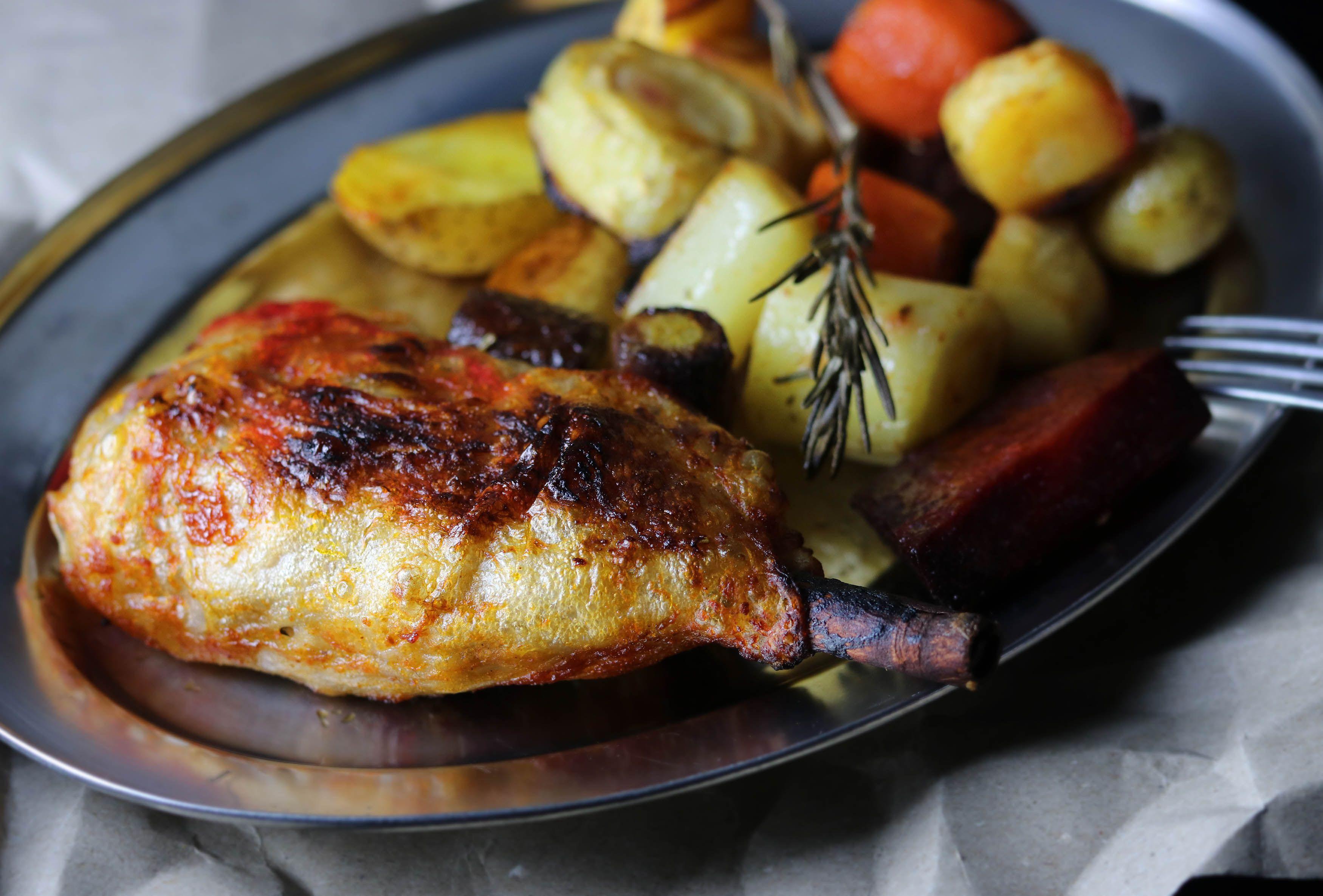 Crispy vegan chicken drumsticks on veggies roasted