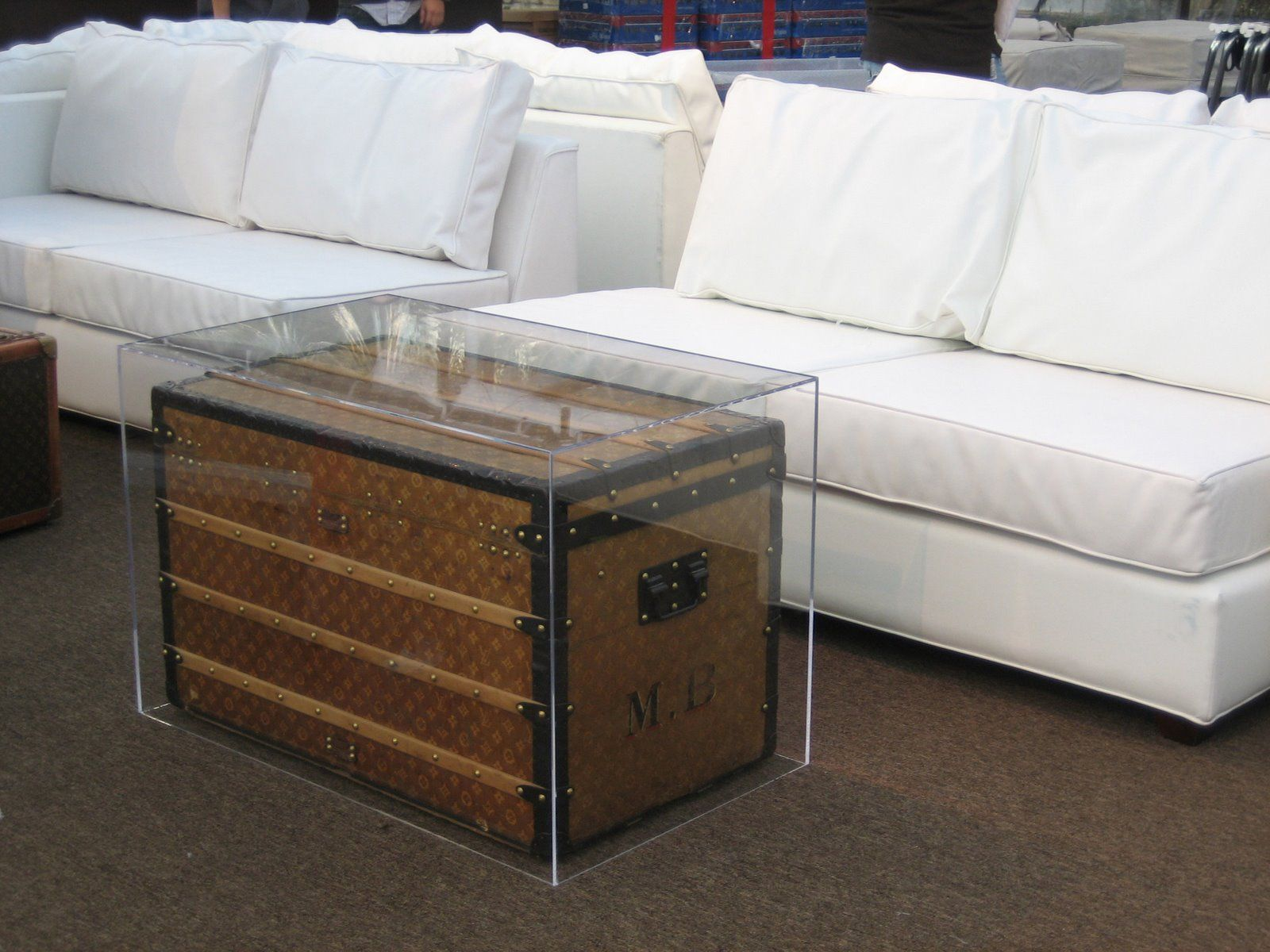 Antique Trunk used as a coffee table Inventive plexiglass cover