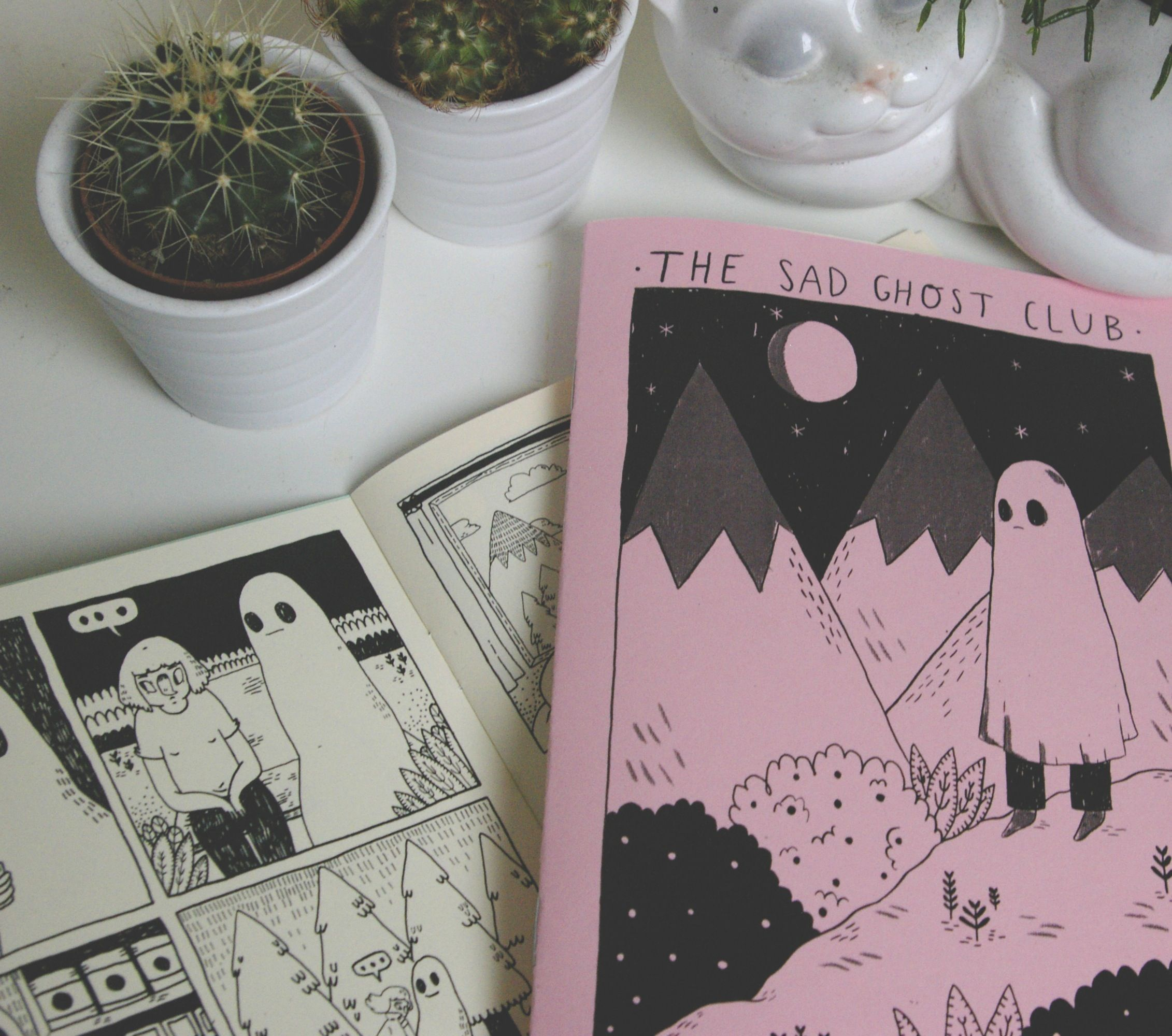 A 16 page comic book zine featuring my original sad ghost club comics.Black and white printed on 120gsm off-white cardstock, front cover options are yellow, green, blue and purple.By purchasing this product you are helping to fund workshops and talks which help young people to understand and learn about their mental health.
