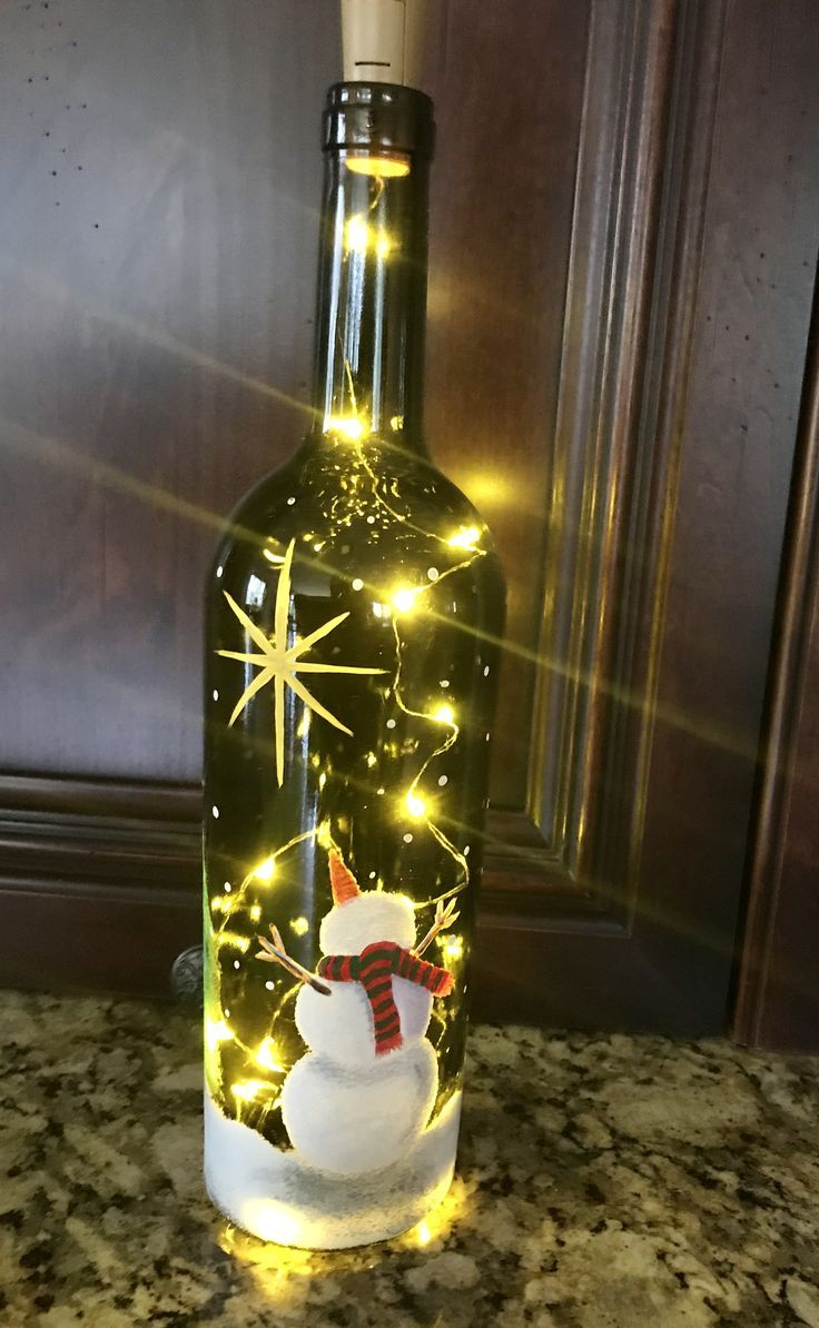 Snowman #painted #on #bottle #with #fairy #lights #inside...first #bottle #I've #painted.,  #... #fairylights