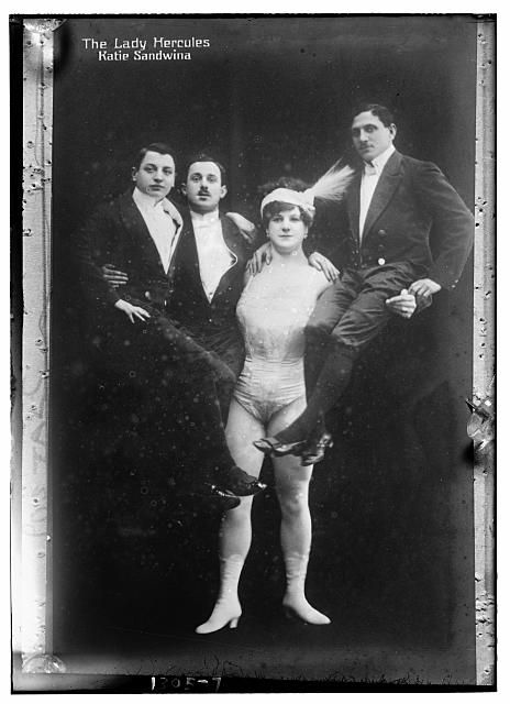 "Katie Sandwina, the Lady Hercules, circus strongwoman (1884 – January 21, 1952) - She once defeated the famous strongman Eugene Sandow in a weightlifting contest in New York. Katie lifted a weight of 300 pounds over her head, which Sandow only managed to lift to his chest. After this victory, she adopted the stage name ""Sandwina"" as a feminine derivative of Sandow.    Sandwina worked in the United States with Ringling Bros. and Barnum  Bailey Circus for many years, until she was nearly 60."