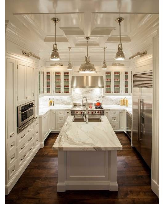 Kitchen design with white cabinets, ceiling detail and pendant lighting.