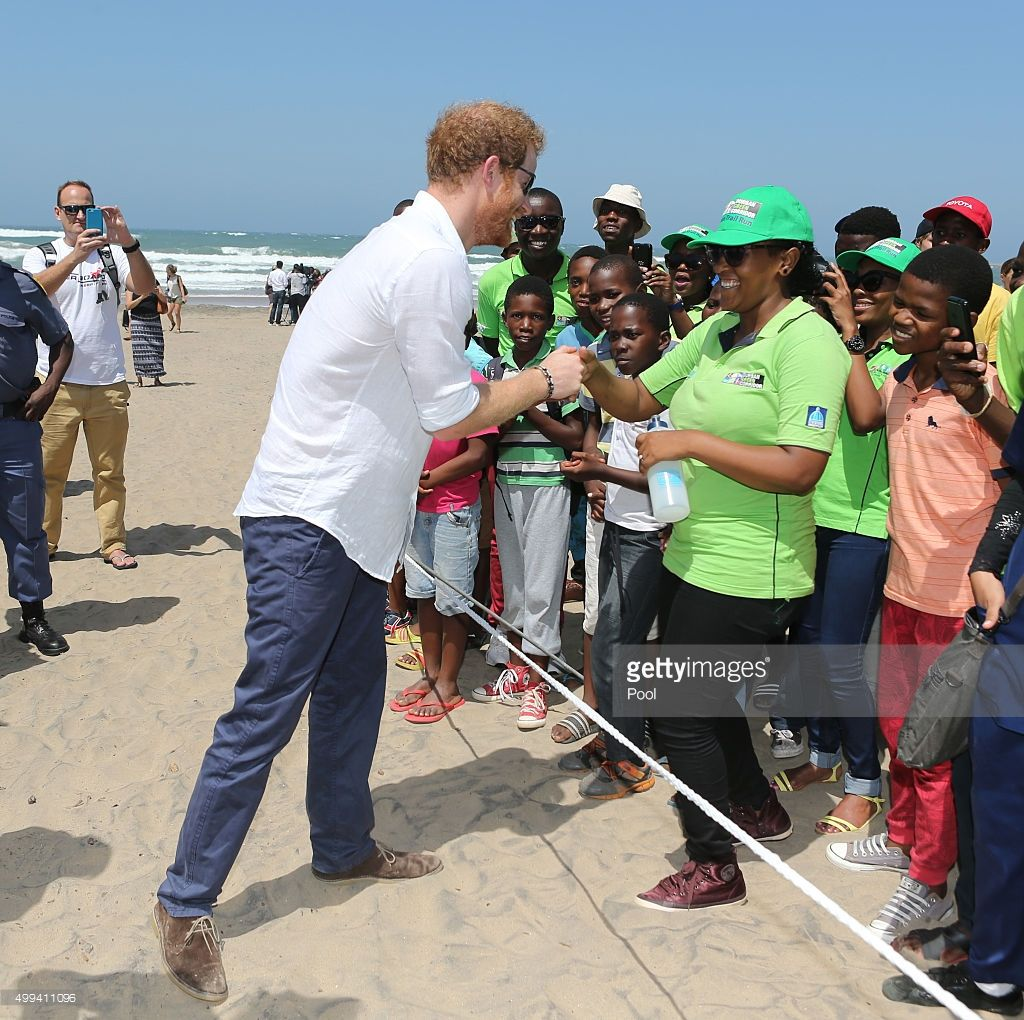 Prince Harry meets locals as he watches Surfers Not Street Children participants demonstrate surf skills at the beach as part of his visit to South Africa on December 1, 2015 in Durban, South Africa.