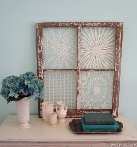 old tatted doilies in an old window frame