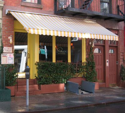Yellow Striped Awning Willow House Greenwich Village Curb Appeal
