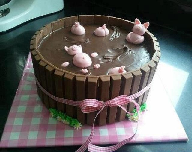 Pigs in a mud wallow! Layer cake with chocolate frosting and Kit-Kat candy bars around the edge for the barrel. Then just add a few pink pigs made from frosting. For more cake ideas, visit http://CakeIdeas101.com