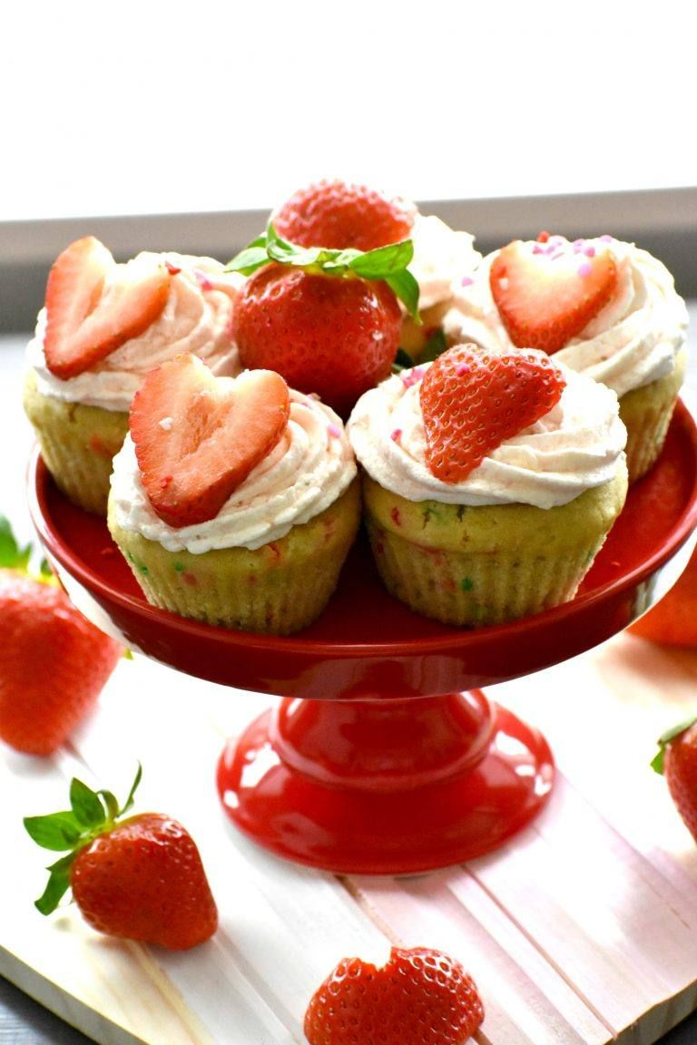 Funfetti cupcakes with strawberry buttercream that are