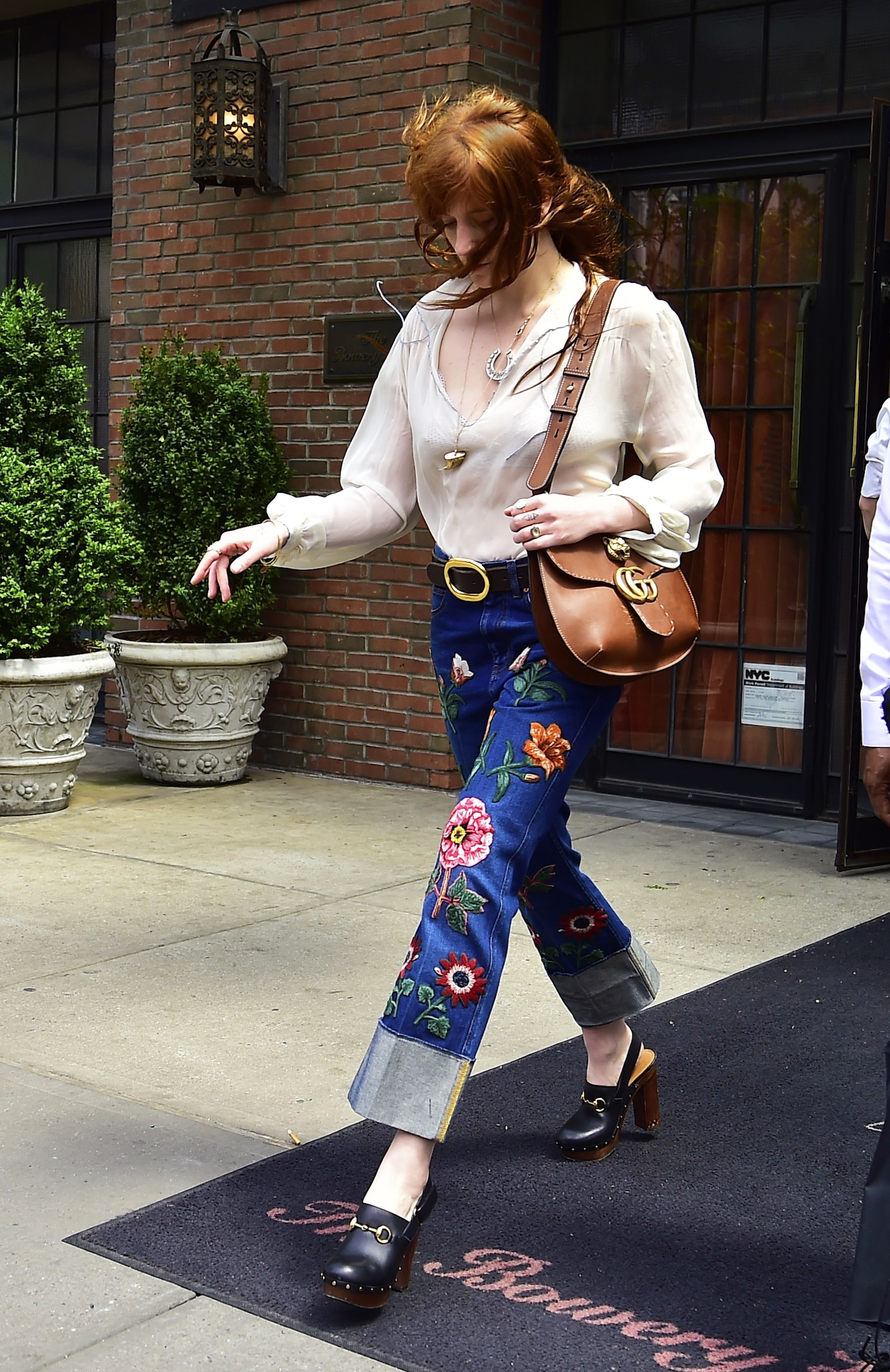 92f465a67b8c Spotted in New York, Florence Welch in Gucci Pre-Fall 2016 patched denim  pants, a GG Marmont shoulder bag and Horsebit clogs.