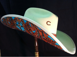 Exquisite hand embellished hats made with only genuine Swarovski crystals. Wear the hat made by the one and only hat designer to the legendary barrel racer June Holeman, and superstars Amberley Snyder, and Chayni Chamberlain.