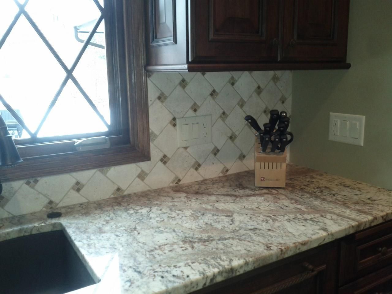 Kitchen Backsplash Diagonal Pattern pinwheel tile backsplash |  shows a stone backsplash installed