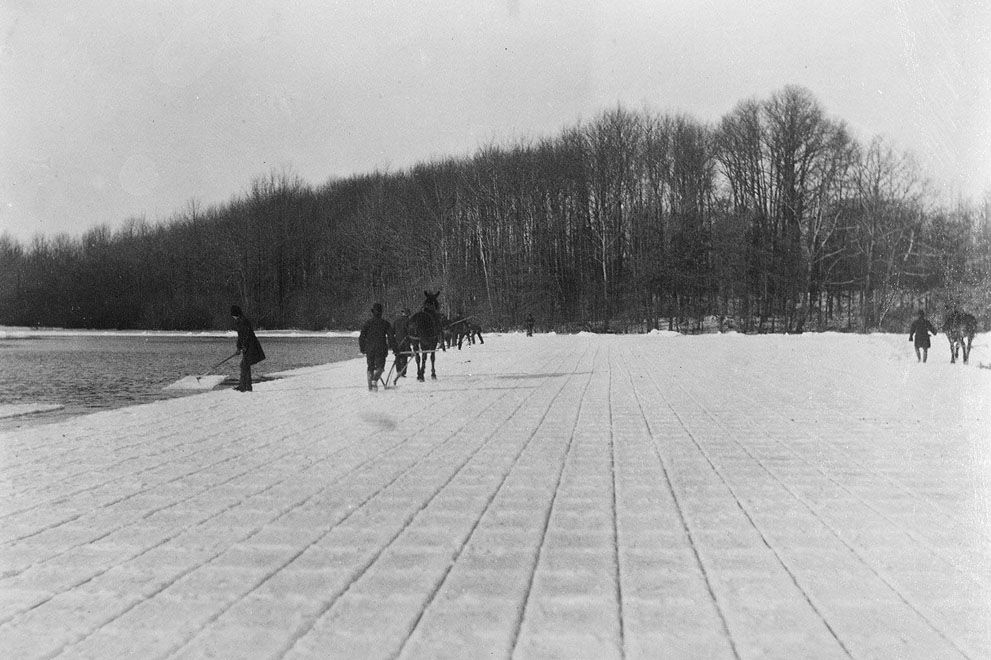 New York City: Men cut ice to be used in old time refrigerators from Kissena Lake in Queens, ca. 1860-1900. (Courtesy NYC Municipal Archives)