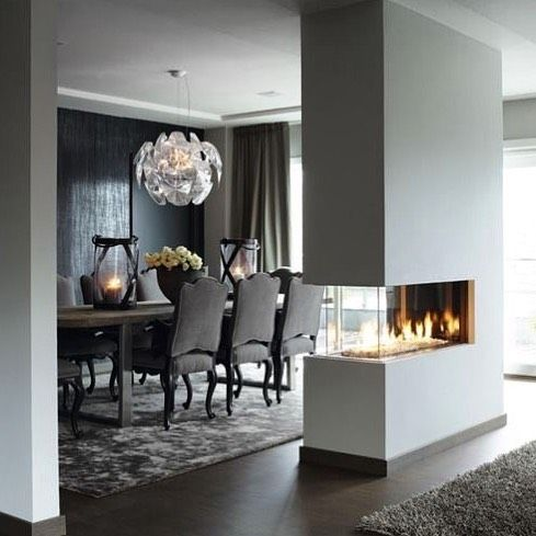 COZY TWO WAY FIREPLACE 🔥 #twowayfireplace #cozy #cozyhome #warm #interiordesign #interior #interiordecor #architecture #perfect #style #awesome #homegoals #inspiration #homeinspo #goals #diningroom #class #stunning #lighting #picoftheday