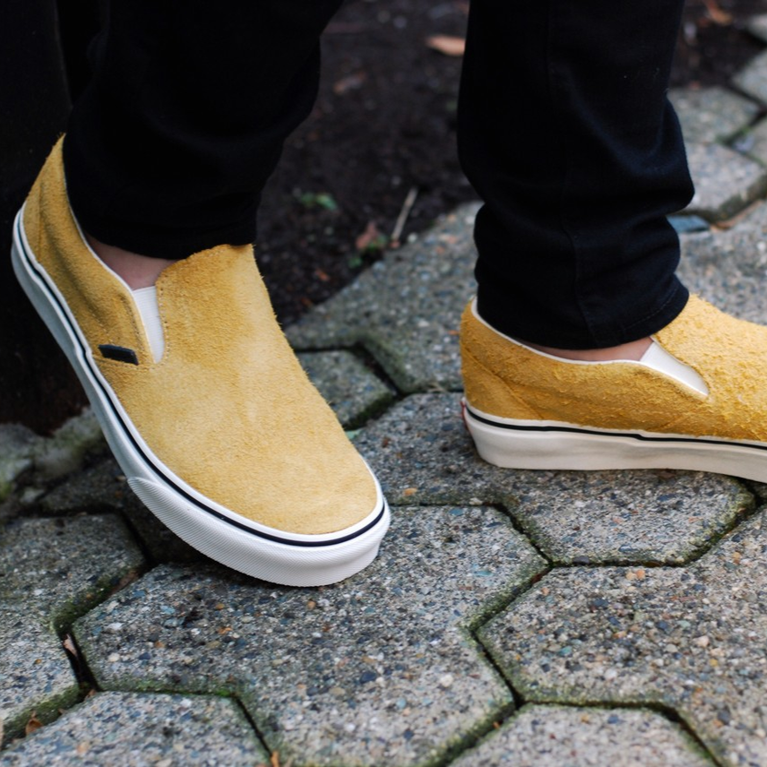 5834cf0056 We can t get enough of these Sunflower  vans Classic Slip-Ons in Hairy  Suede. Shop now!