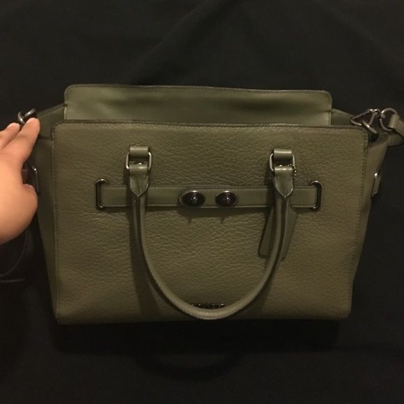 Coach Blake carryall in olive green! I love the color of this purse, though it did not work for me. It's a tad to small for my day to day necessities, although it is a really good size. Only used it for a week, so it's pretty much brand new. No scratches or stains. Great on trend color as well! Coach Bags Satchels