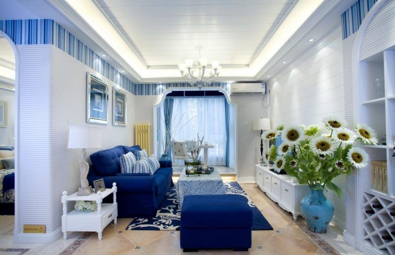 Living Room Natural Living Room Interior Design With Blue Fabric Sofa And Floral Table Cover On Blue Floral Rug Including Flower Vase Beside White Wooden Vanity And Led Lighting Ceiling And Chandelier How to Put the Most Exciting and Exotic Houseplant in Green Living Room
