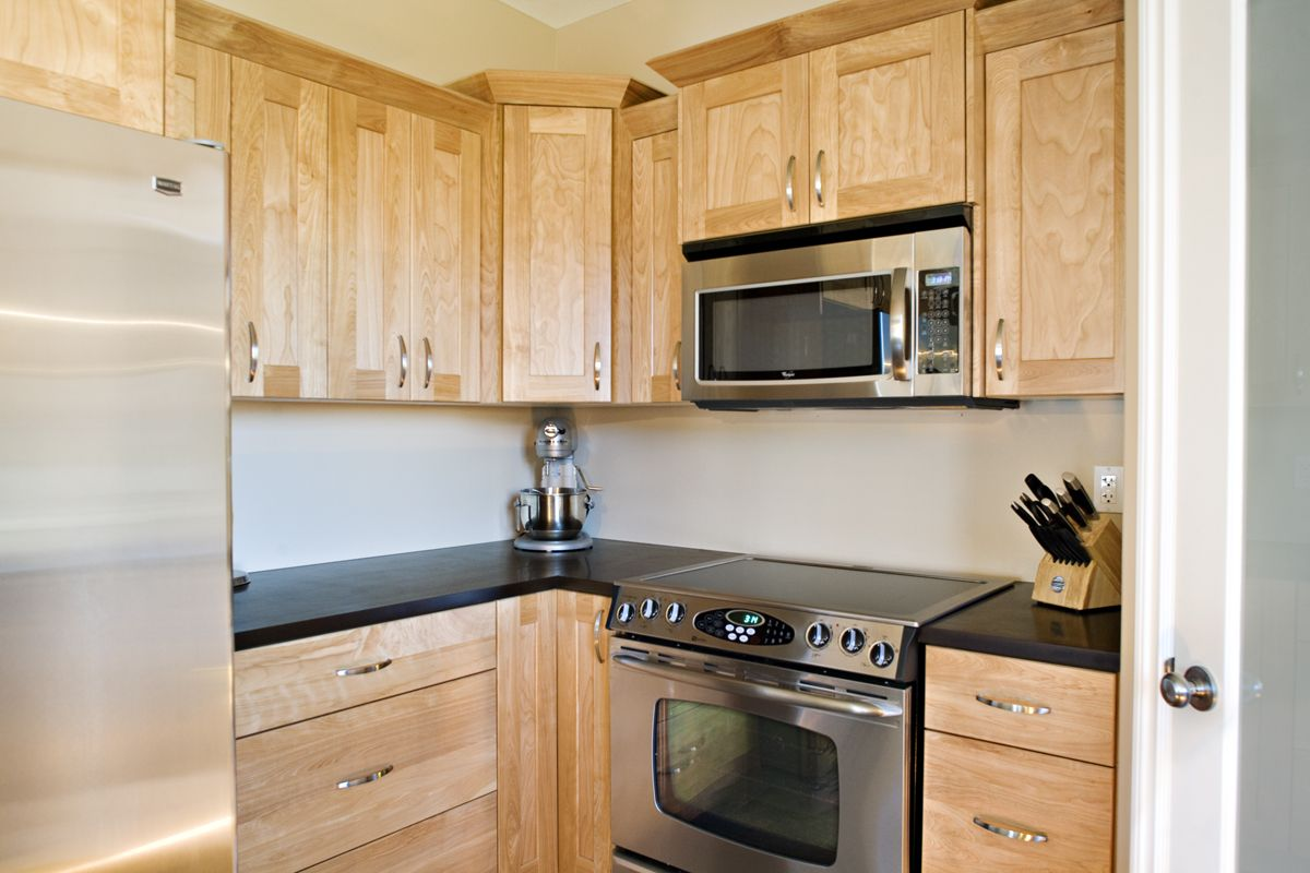 Matching Countertops With Cabinets Wooden Birch Cabinets With Black Counter Tops To Match