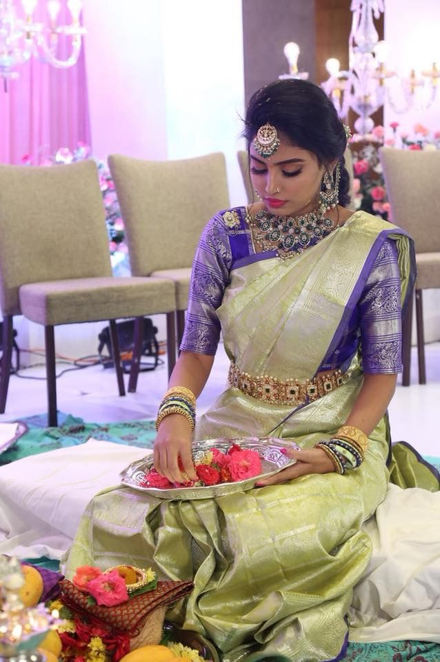 Really like the color combo of the saree and blouse. Its unique.