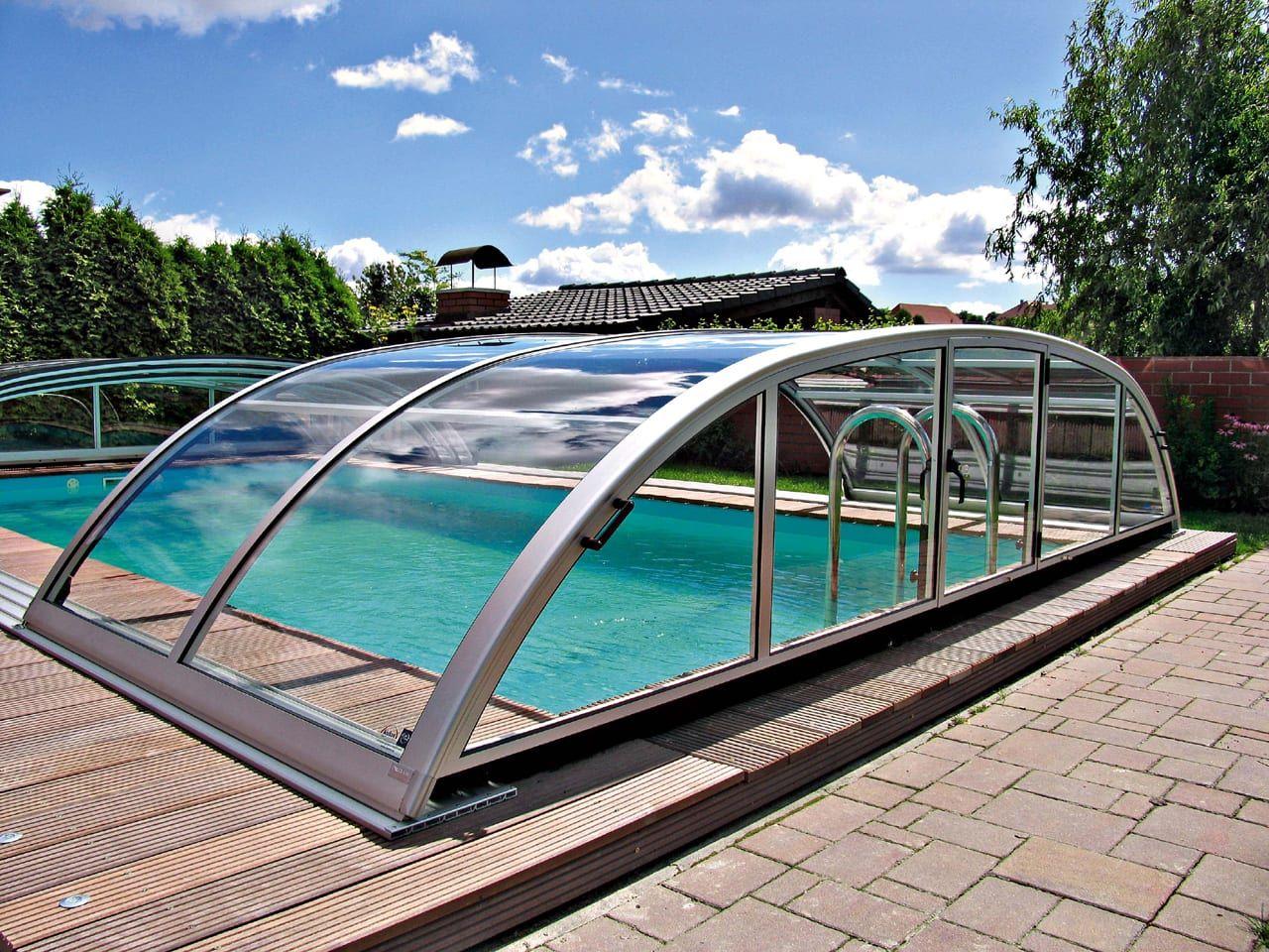 Elegant lowlevel modular pool enclosure in ground pool