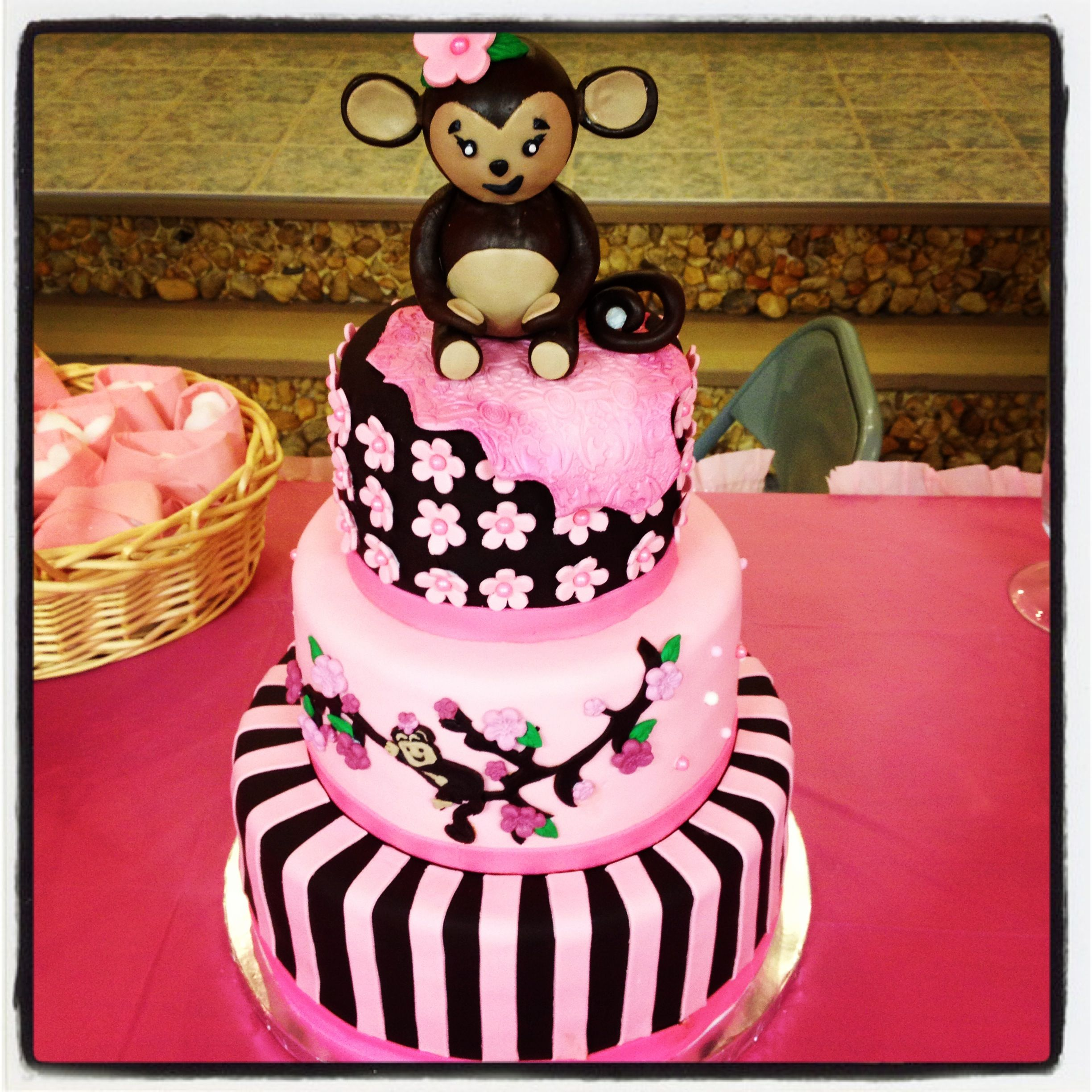 Monkey girl baby shower cake pink and brown