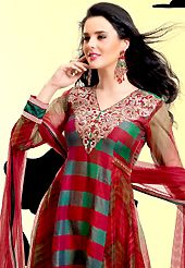 Try out this year top trend, glowing, bold and natural collection. The dazzling red and green net churidar suit have amazing embroidery patch work is done with resham, zari, sequins, stone and lace work. The entire ensemble makes an excellent wear. Matching green santoon churidar and red net dupatta is available with this suit. Slight Color variations are possible due to differing screen and photograph resolutions.