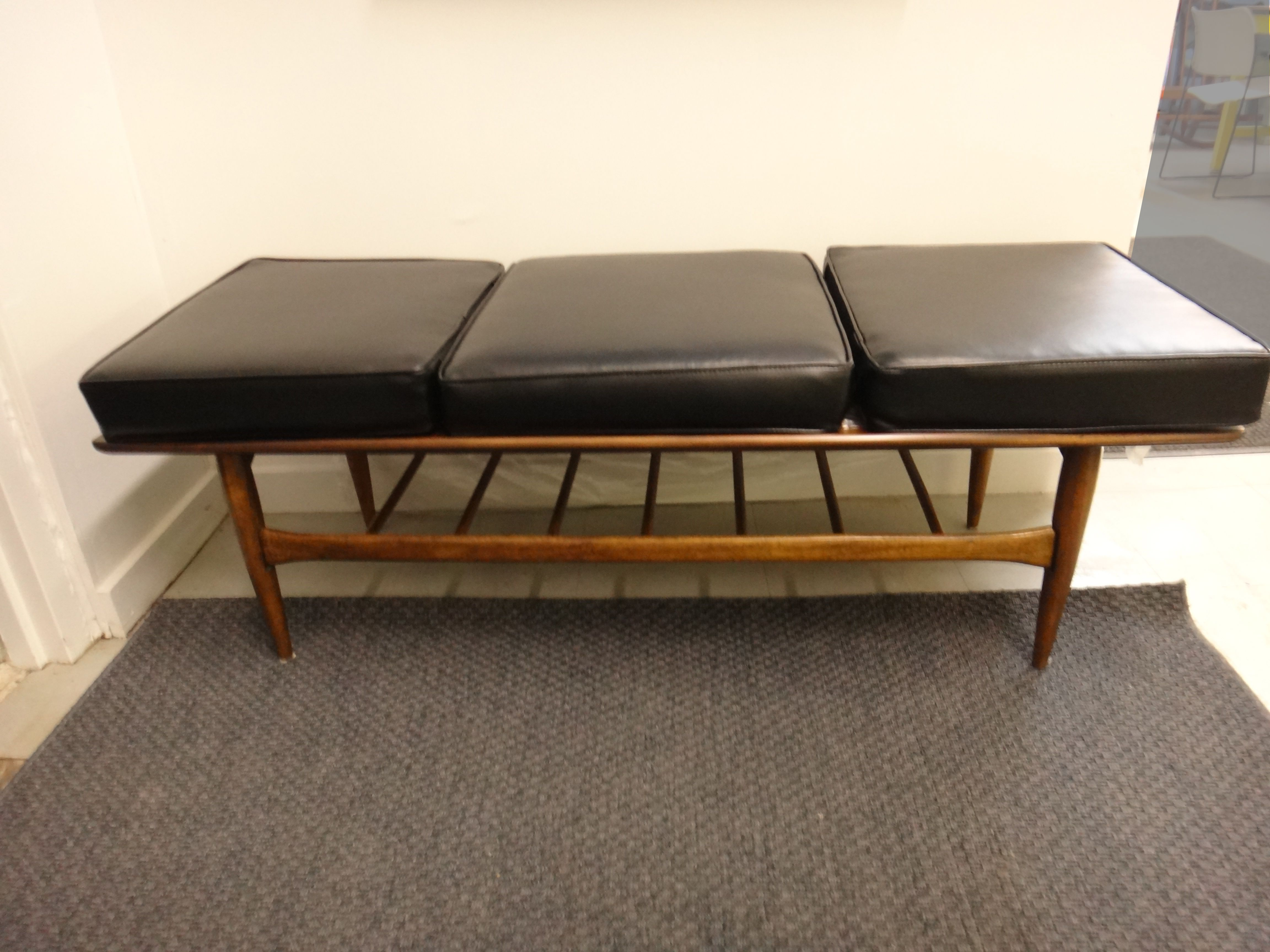 Our customer purchased this Danish modern coffee table from us and then asked us to make black vinyl cushions to fit across the top.