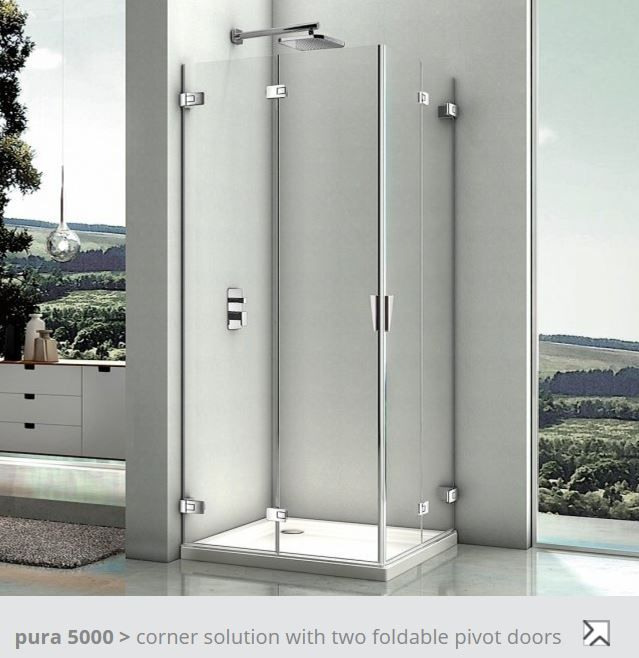 corner shower with two foldable pivot doors that fold to wall when ...