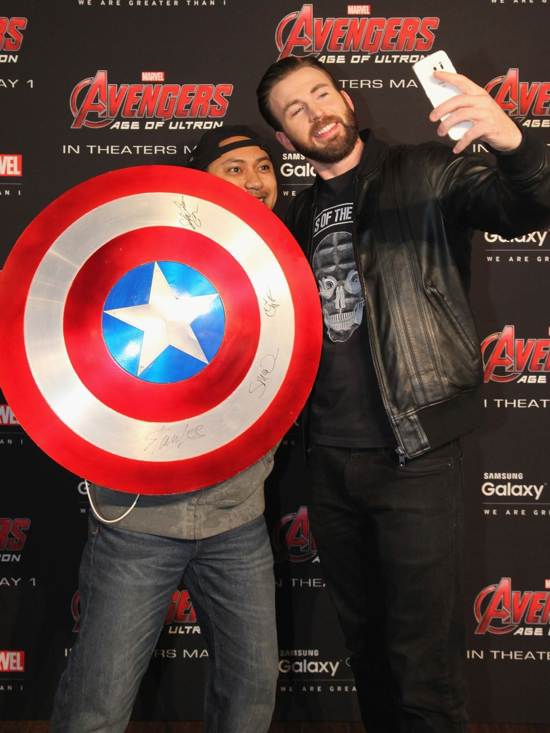 Chris Evans Poses With A Fan During A Meet And Greet In New York