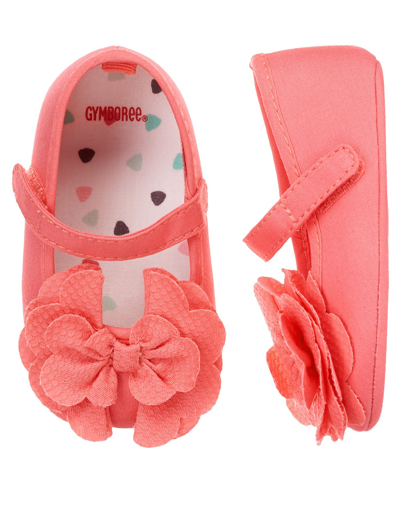 A bright bow for her toes. Fashionable cotton crib shoe features fancy scallop bows.