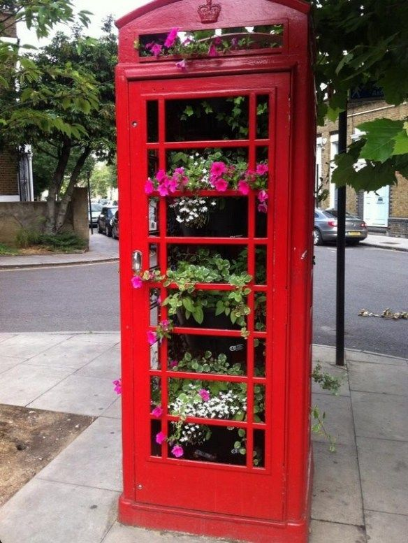 A Red Telephone Booth Flower Garden