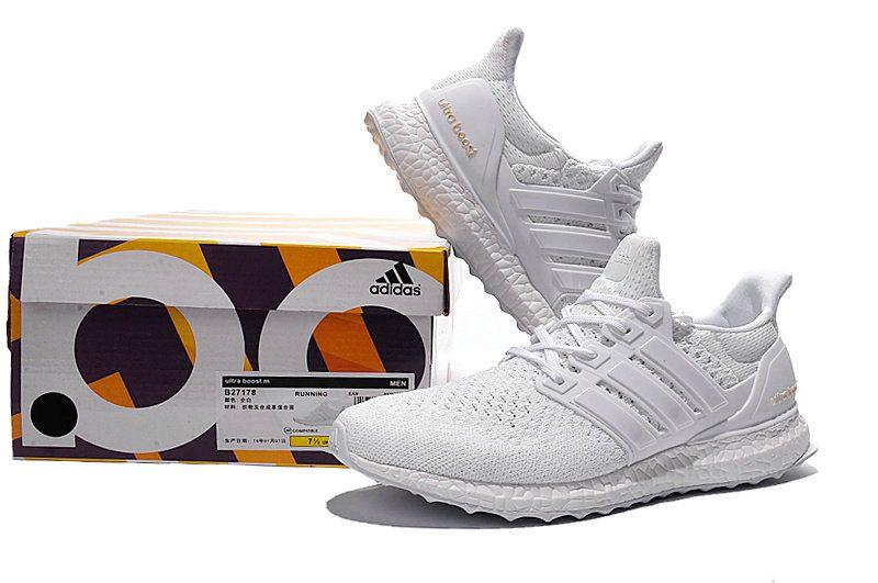 the best attitude 2803a 3dbf7 Chaussures de mode adidas Ultra Boost 2015 2016 PrimeKnit White blanc White  blanc Orange Youth Big Boys Sneakers