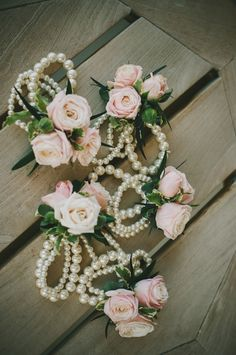 Pink rose and pearl corsages. Calie Rose Floral & Event Design.   photography by