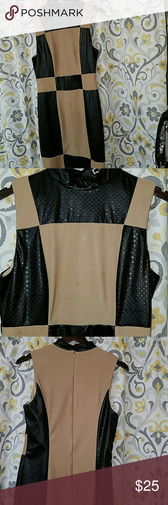 Beautiful dress! Leather like material. This dress is so pretty! Its tan & black, leather like material, fully lined. Perfect with leggings and hills. nikiBiki Dresses Midi
