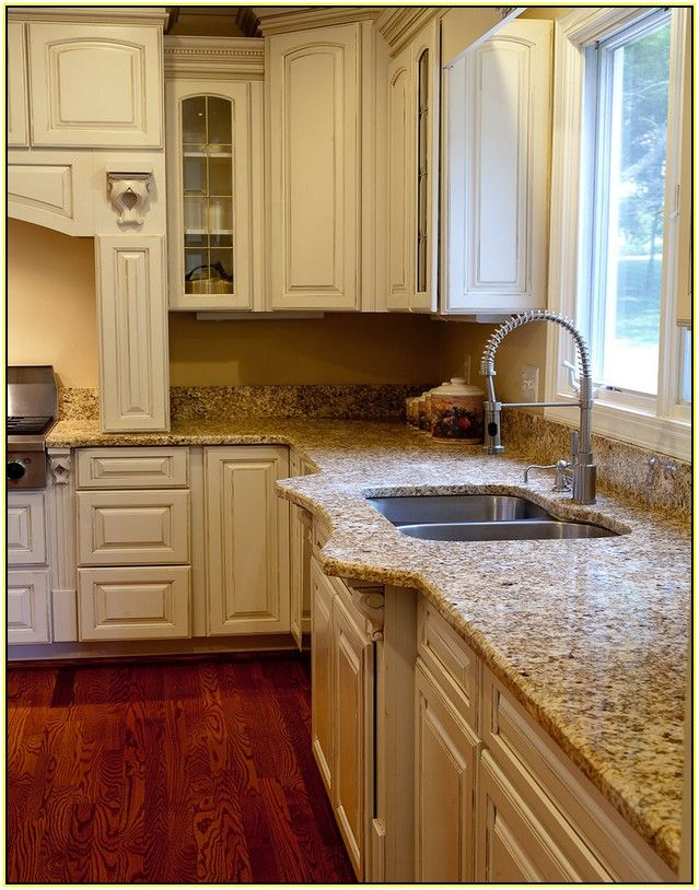 Granite Sandstone Countertop With Tan Cabinet Kitchen Design Ideas ~ White kitchen cabinets with brown granite countertops home
