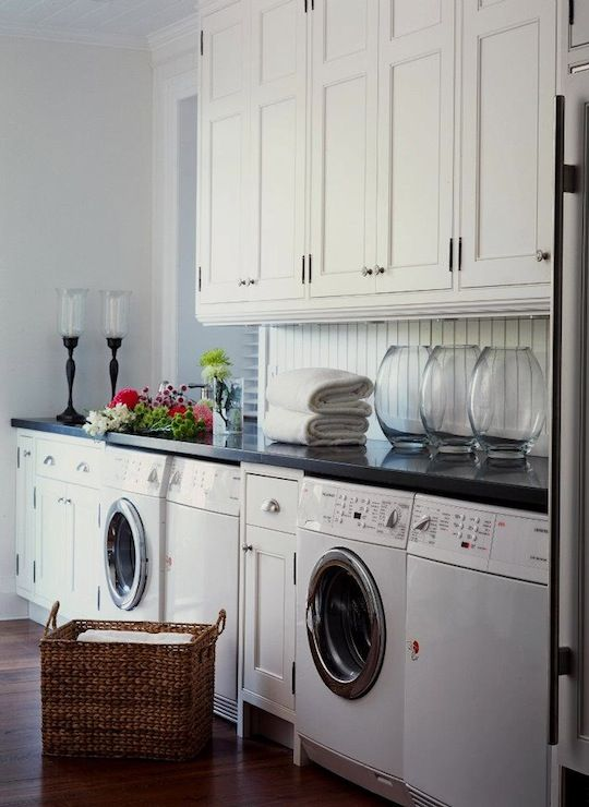Beautiful Cottage Laundry Room With Wall To And Floor Ceiling White Shaker Cabinets Crown Molding Paired Polished Black Granite