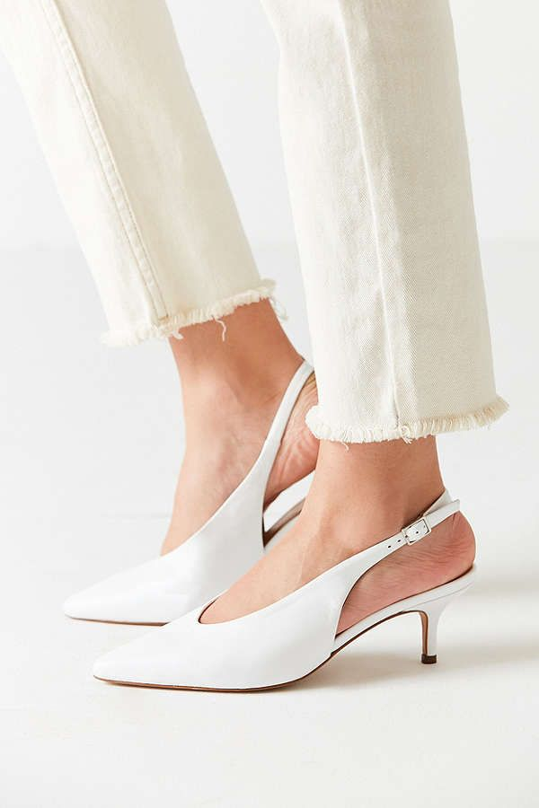 8f81f51b727 White slingback kitten heel shoe paired with white denim with a frayed edge