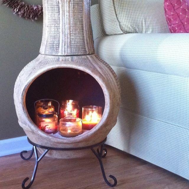 Creative Indoor Chiminea Candle Holder With Black Iron Stand For Living Room Decoration Ideas