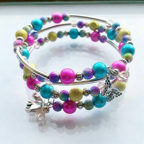Bright colours memorywire wrap around bracelet.  #brightcolours #bracelet #wraparound #butterflycharm #elephantcharm