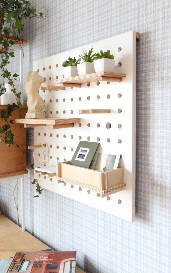 Pegboard display, pegboard organizer, plywood peg board shelves, wall decor, office pegboard.