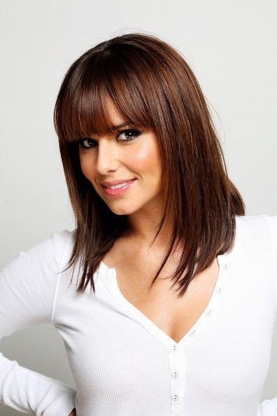 Shoulder length cut with slight feathering in the front and heavy square fringe.  Chocolate demi-permanent color.