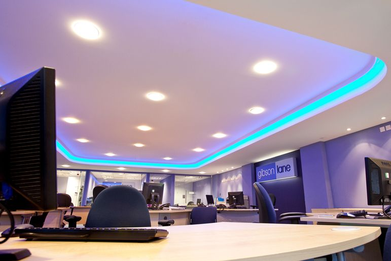 We created a feature ceiling with inset LED light in neon blue for a