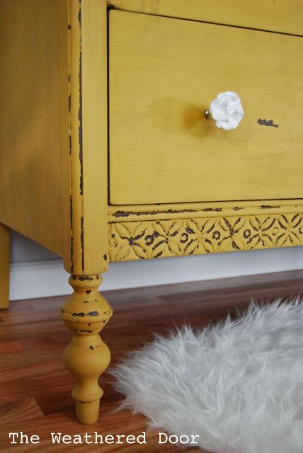 A chippy, mustard yellow dresser