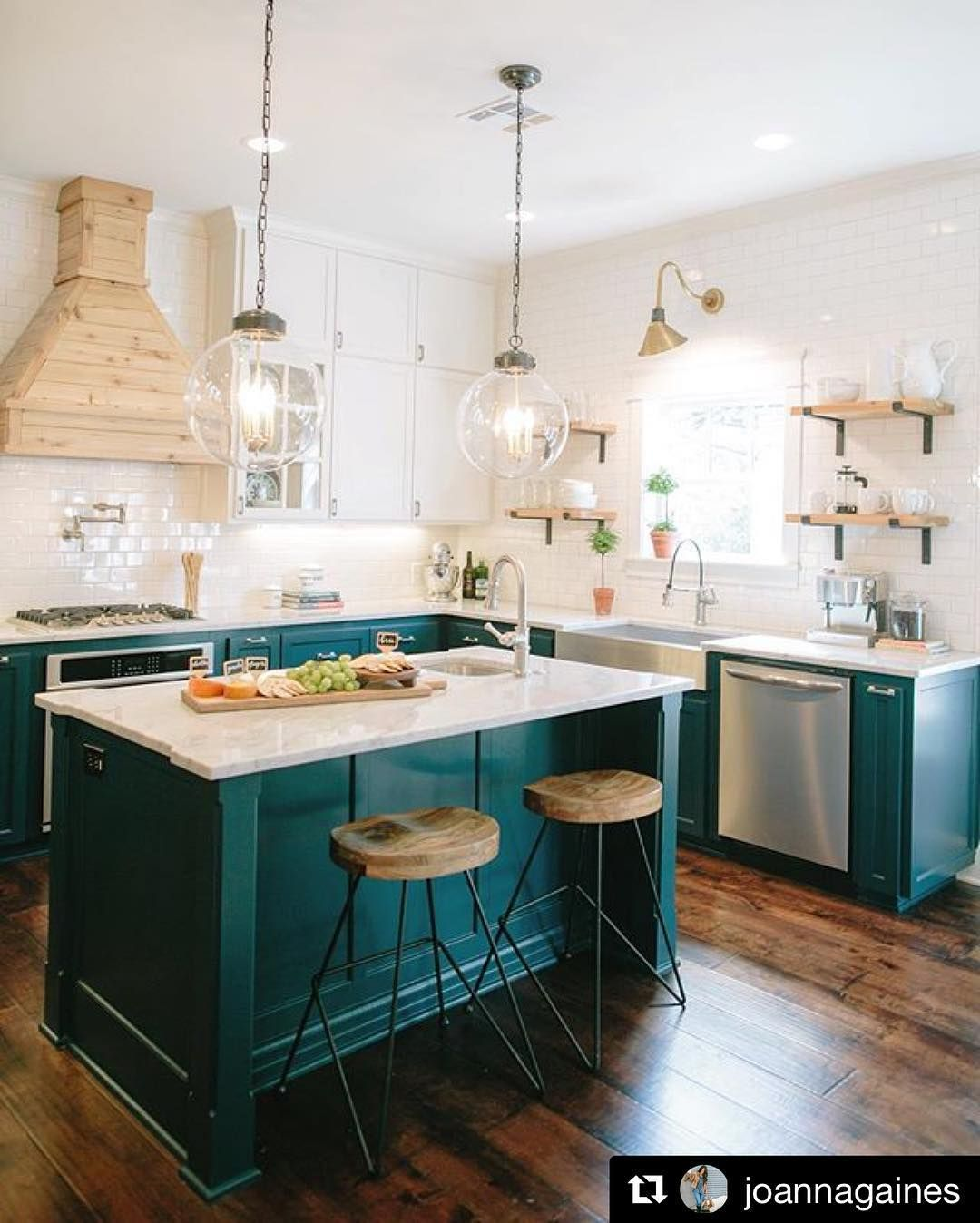 SWOON! How gorgeous are these teal cabinets?! LOVE the gold accents ...