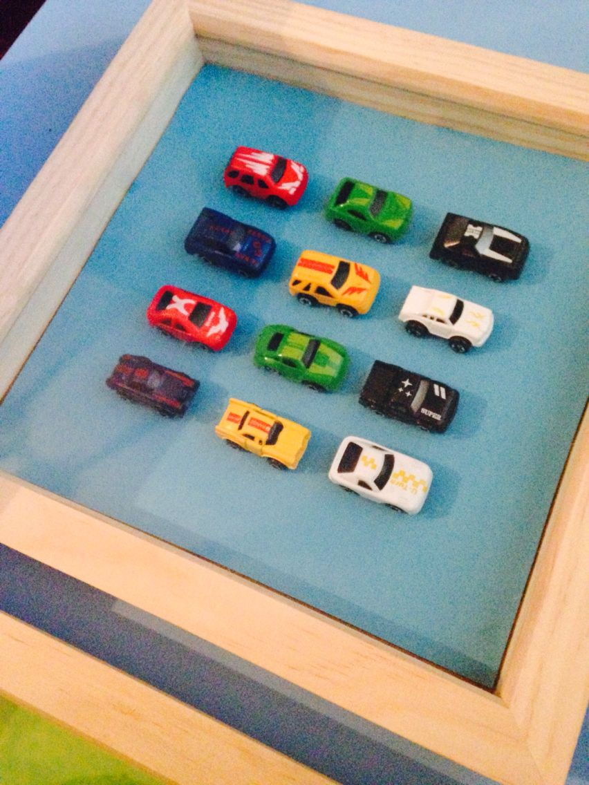 8x8 Bedroom Design: Shadow Box Frame With Toy Cars Displayed For Boys Bedroom