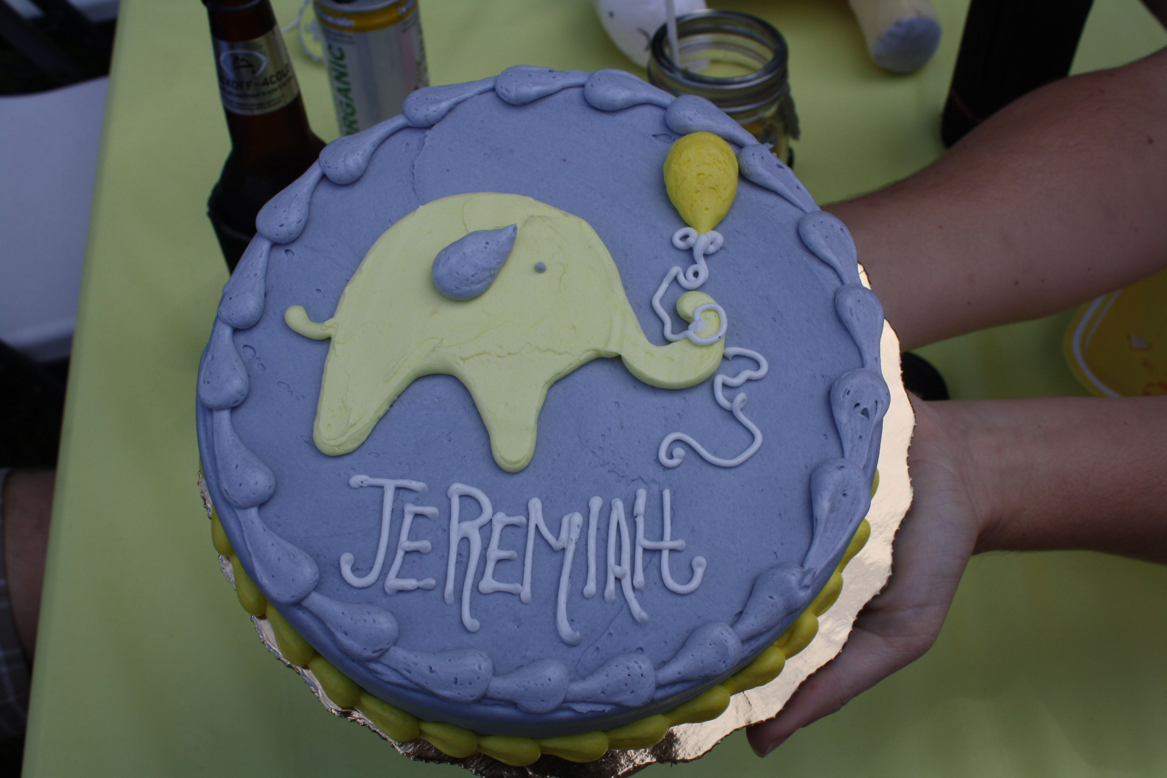 Gray and yellow elephant first birthday smash cake from